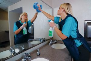 Cleaning bathroom mirror-ServiceMaster Clean, Fairport, Penfield, Pittsford, Webster, Greece, Chili, Rochester, NY