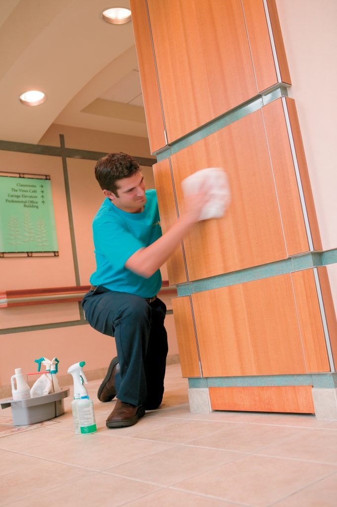 ServiceMaster cleaning employee at a company pillar